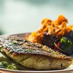 Pan-seared sea bass. With a fresh side of beetroots and sweet potato chips