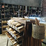 Fresh bread from our bakery. Vitrine with delicatessen: meats and cheeses.