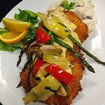 Chicken Oscar-topped with grilled asparagus, mushroom, artichoke, sundried tomato hollandaise