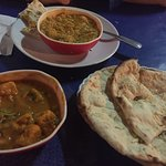 Green peas with tofu Marsala and Baked eggplant and potato curry with garlic naan!  Amazing!