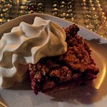 Raspberry crumble with whipped cream