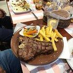 Beautiful paella & steaks.