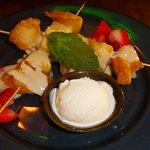 Fried Wontons (9.99) of skewers of fresh pineapple and cream cheese wontons, & vanilla ice cream