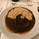Steak with sauce and risotto