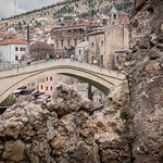 The Stari Most tucked behind nearby rubble.