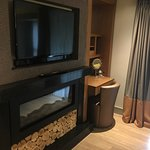 TV and dressing area in bedroom.