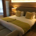 Bedroom with en suite bath tub.