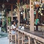Our standing bar is the perfect place to catch up on emails and watch the activity of Gili pass