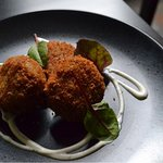 Chorizo, button mushroom croquettes, baby leaf and yoghurt & herb sauce