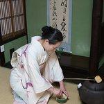 The tea master preparing matcha