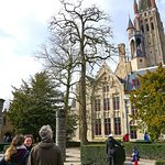 Learning about the Notre Dam of Bruges - and an adjoining mansion.
