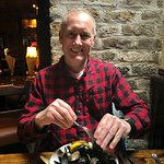 Happy man who loves mussels