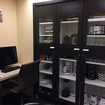 Cupboard (appliances, games, puzzles) and a parial of the business center