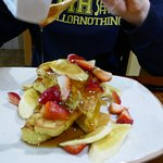 French toast with syrup, fresh bananas and strawberries