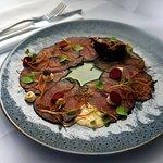 Carpaccio of Beef Fillet, Fried Enoki, Juniper Creme, Amaranth