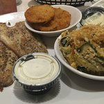 Undercooked blackened Catfish, excellent squash souffle and overbreaded fried green tomatoes.