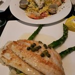 Dover Sole with Herb Risotto in front, Seafood Pappardelle in back