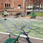 A kid proudly attempting 100 Pogo jumps as his father looked on -Hunter College playground