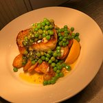 pan fried hake on new potatos with minted peas