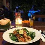 Balinese style paella dish full of calamari , prawn, white fish clams, tomato sambal & fragrant