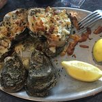 """Chargrilled"" oysters were more likely baked, tough, and covered in a crusty cheese."
