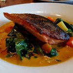 Crispy pan roasted trout on veg in coconut thai curry sauce. Yum