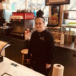 The very friendly, Jennifer, at the original counter, which was once used as a soda fountain!