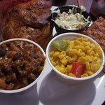 Half chicken with baked beans, corn, cole slaw and cornbread