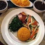 Brazilian black beans and yellow rice with vegetables and fried plantains