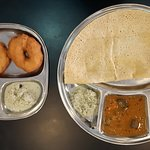 Plain Dosai (big plate) and Vada (small plate)