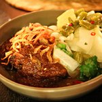 Southern Thai style slow cook beef cheek in rich Muslim curry sauce served with pickles and chil