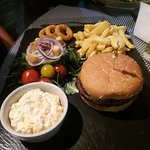 Homemade Black Angus Beefburger with chips and Salad.