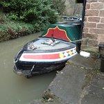 Canal boat adjacent cafe