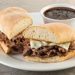 French dip sandwich with au jus from Café at the Meadows.