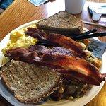 Scrambled eggs, bacon and potatoes