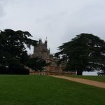 Highclere Castle peeping through the trees.