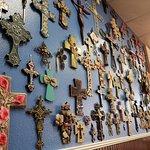 Wall of crucifixes at restaurant