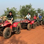 Family stops for a photo during the Quad Adventure Cambodia tour.