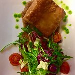 Goats cheese parcel on fig sauce and salad