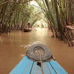 Rowing boat on the Mekong river
