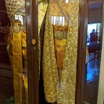 traditional costumes shown in a museum