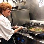 Kathleen preparing meatball entree.