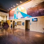 "The Ben Miller Lobby features ""The Mediatrix,"" a one-of-a-kind fresco by renowned artist Mark Ba"
