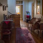 Entry hall and registration area filled with antique charm and sunlight