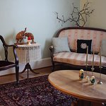 The front parlor is comfortable and charmingly cosy; a great place to plan your adventures!