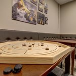 Crokinole is a great family game.  Easy to learn and play!