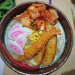 Hokkaido ramen with add on of fish cake and shrimp tempura