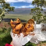 Chocolate croissant atop Saddle Road cinder cone. Mauna Kea in the distance.