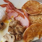 Beautiful coast big breakfast, and the pancakes with bacon and added poached eggs (stole the hus