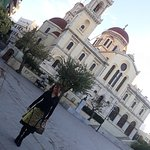 My wife Mihaela poses in front of St. Minas, in the square